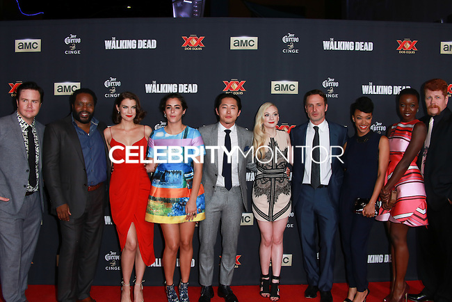 UNIVERSAL CITY, CA, USA - OCTOBER 02: Josh McDermitt, Chad L. Coleman, Lauren Cohan, Alanna Masterson, Steven Yeun, Emily Kinney, Andrew Lincoln, Sonequa Martin-Green, Danai Gurira, Michael Cudlitz, Melissa McBride, and Norman Reedus  arrive at the Los Angeles Premiere Of AMC's 'The Walking Dead' Season 5 held at AMC Universal City Walk on October 2, 2014 in Universal City, California, United States. (Photo by David Acosta/Celebrity Monitor)