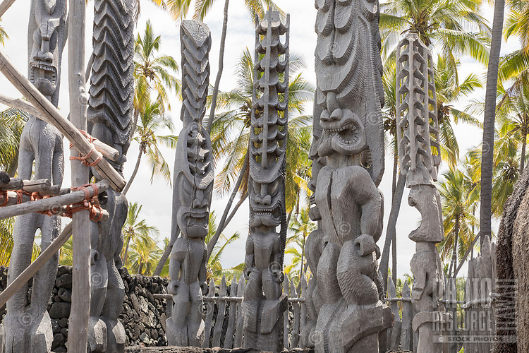 Ki'i or tiki (carved images) near a recreated heiau or temple at Pu'uhonua o Honaunau, Hawai'i Island.
