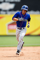 Thomas Field (2) of the Tulsa Drillers rounds the bases after hitting a home run during a game against the Springfield Cardinals at Hammons Field on June 27, 2011 in Springfield, Missouri. (David Welker / Four Seam Images)