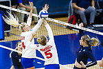 PENSACOLA, FL - DECEMBER 09: Allie Geary (4) and Sydney Marshall (5) of Florida Southern College miss a block attempt during the Division II Women's Volleyball Championship held at UWF Field House on December 9, 2017 in Pensacola, Florida. (Photo by Timothy Nwachukwu/NCAA Photos via Getty Images)
