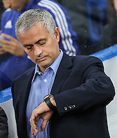 Jose Mourinho (Manager) of Chelsea checks his watch for the time ahead of the UEFA Champions League match between Chelsea and Maccabi Tel Aviv at Stamford Bridge, London, England on 16 September 2015. Photo by David Horn.