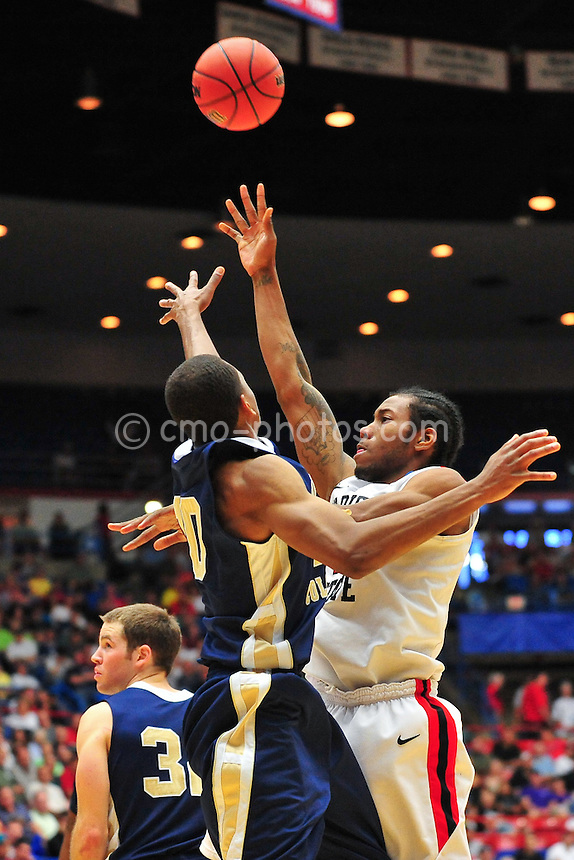 Mar 17, 2011; Tucson, AZ, USA; San Diego State Aztecs forward Kawhi Leonard (15) shoots the ball in the second half of a game against the Northern Colorado Bears in the second round of the 2011 NCAA men's basketball tournament at the McKale Center. The Aztecs won 68-50.