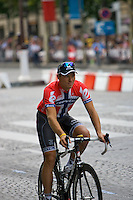 Thor Hushovd rides a lap of the Champs Elysees, during the team parade lap at the 2010 Tour de France in Paris