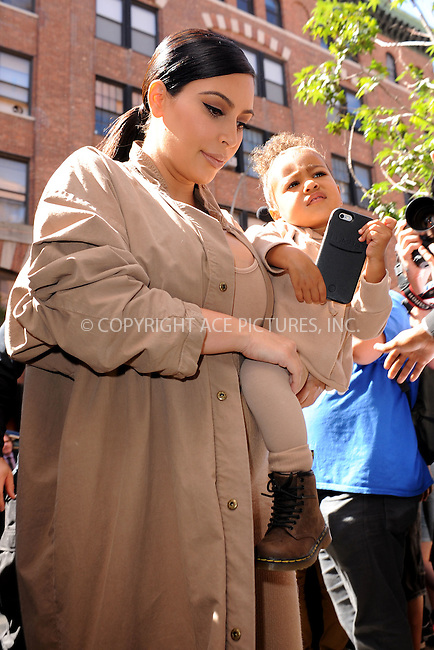 WWW.ACEPIXS.COM<br /> September 16, 2015 New York City<br />  <br /> Kim Kardashian and North West arriving to attend Kanye West Fashion Show <br /> September 16, 2015 in New York City<br /> <br /> Credit: Kristin Callahan/ACE<br />  <br /> Tel: 646 769 0430<br /> Email: info@acepixs.com<br /> www.acepixs.com
