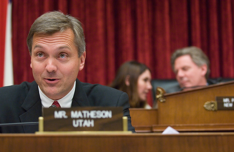 WASHINGTON, DC - April 24: Rep. Jim Matheson, D-Utah, during the House Energy and Commerce Subcommittee on Health hearing on overhauling the FDA. In background, Chairman Frank Pallone Jr., D-N.J., talks with an aide. Rep. John D. Dingell is putting his considerable clout behind an ambitious import safety and Food and Drug Administration overhaul bill. But the opposition it is generating from almost every corner of the business world may prove to be a formidable counterweight. From local port authorities to the seafood industry -- with drugmakers and grocers in between -- private industry groups and lobby organizations are concerned about the draft bill's dozens of new regulations on drug and food imports and safety. (Photo by Scott J. Ferrell/Congressional Quarterly)