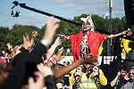 © Joel Goodman - 07973 332324 .  07/06/2015 . Manchester , UK . GRACE JONES is carried alongside the crowd on the shoulders of a security guard as she performs on the main stage at The Parklife 2015 music festival in Heaton Park , Manchester . Photo credit : Joel Goodman
