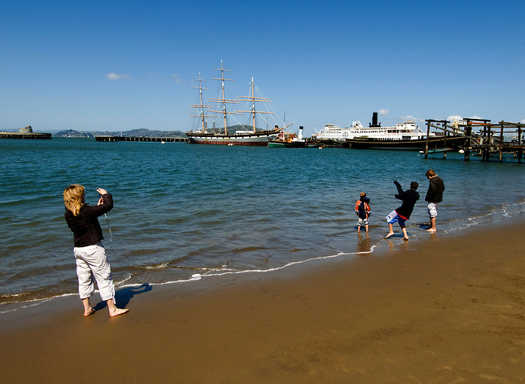 California, San Francisco: A family enjoys Aquatic Park, adjacent to the Hyde Street Pier.Photo #: 13-casanf78305.Photo © Lee Foster 2008
