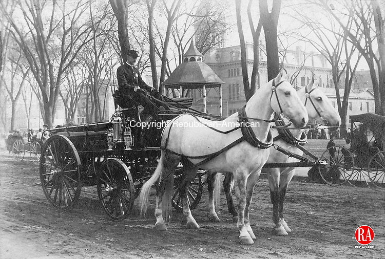Driver and team at the ready for an annual fire department equipment inspection, circa 1900.