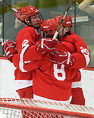 Sean Collins (Cornell - 12), Locke Jillson (Cornell - 8) and Dustin Mowrey (Cornell - 20) celebrate Jillson's goal in the second period. - The visiting Cornell University Big Red defeated the Harvard University Crimson 2-1 on Saturday, January 29, 2011, at Bright Hockey Center in Cambridge, Massachusetts.