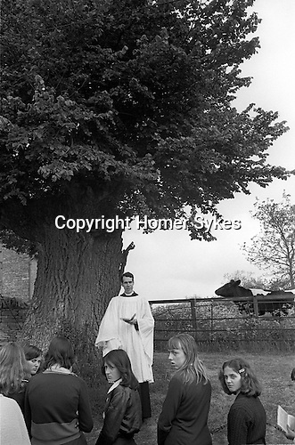 The Wicken Love Feast, takes place on Ascension Day and celebrates the joining together of two parishes in 1587. Wicken Northamptonshire 1970s Uk.  Open air service under the Gospel Elm <br />