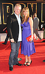 "HOLLYWOOD, CA. - April 26: Composer John Debney and wife Lola Debney arrive at the ""Iron Man 2"" World Premiere held at the El Capitan Theatre on April 26, 2010 in Hollywood, California."