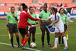 20 October 2014: Captains Maylee Attin (TRI) (9) and Coralia Monterroso (GUA) (14) shake hands and exchange banners before the game in front of the match officials. From left: Assistant referee Enedina Caudillo (MEX), Referee Lucila Venegas (MEX), Fourth official Mauree Skeete (GUY), and Assistant referee Kimberly Moreira (CRC). The Trinidad & Tobago Women's National Team played the Guatemala Women's National Team at RFK Memorial Stadium in Washington, DC in a 2014 CONCACAF Women's Championship Group A game, which serves as a qualifying tournament for the 2015 FIFA Women's World Cup in Canada. Trinidad and Tobago won the game 2-1 to secure advancement to the semifinals.
