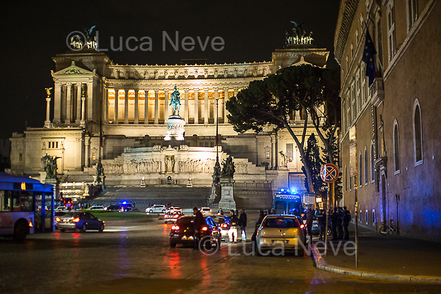 Piazza Venezia.<br /> <br /> Rome, 02/05/2018. Following and documenting a group of Liverpool F.C. supporters chanting and cheering on throughout the streets of central Rome while waiting for the Champions League Semi-final (second leg) at the Stadio Olimpico versus A.S. Roma. The supporters were escorted by heavy presence of the Italian Police and Carabinieri, assisted by Merseyside Police's officers (British Police) and by the stewards and staff from Liverpool Football Club. Last week, during the first leg of the semi-final in Liverpool, an English fan was attacked by Italian supporters outside Anfield stadium. However, the day of the match in Rome passed without any serious incidents involving supporters and just one arrest - a Liverpool supporter - was made (on suspicion of common assault and a public order offence). The actual match was played in the evening and saw Liverpool losing 4-2 but due to the aggregate with the first match, 7-6, the &quot;Reds&quot; conquered the access to the Champions League final in Kiev against Real Madrid. A statement from the English club read: &quot;Liverpool would like to thank all supporters who travelled to Rome for Wednesday evening's Champions League meeting with Roma at Stadio Olimpico for their exemplary conduct. Over 5,000 fans made the journey to the Italian capital for yesterday's semi-final second leg, behaving impeccably throughout, with no major incidents reported. LFC also acknowledges the significant resources deployed by Roma, UEFA, Merseyside police, Italian police and security services in Rome to ensure all fans enjoyed a safe visit.&quot;<br /> <br /> For more info about the football teams please click here: http://www.asroma.com/en &amp; http://www.liverpoolfc.com/