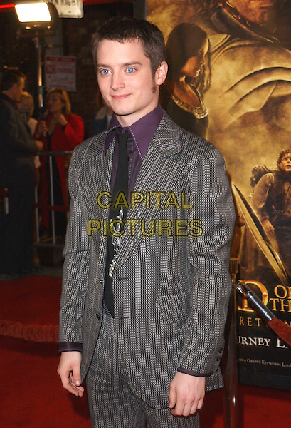 ELIJAH WOODS.The Lord of The Rings:The Return of The King L.A. Premiere held at The Mann Village Theatre.                  03/12/2003.half length, half-length.www.capitalpictures.com.sales@capitalpictures.com.©Capital Pictures.