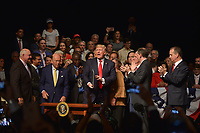 MIAMI, FL - JUNE 16: U.S. President Donald Trump speak to a crowd of people and sign an executive order policy changes toward Cuba with Sonny Perdue, Mario Diaz-Balart, Wilbur Ross, Marco Rubio, Rick Scott, Cary Roque , Mike Pence and  Alexander Acosta standing behind him at the Manuel Artime Theater in the Little Havana neighborhood on June 16, 2017 in Miami, Florida. The President will re-institute some of the restrictions on travel to Cuba and U.S. business dealings with entities tied to the Cuban military and intelligence services.  Credit: MPI10 / MediaPunch
