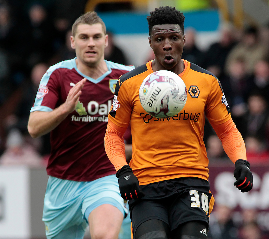Burnley's Sam Vokes chases down Wolverhampton Wanderers' Kortney Hause<br /> <br /> Photographer David Shipman/CameraSport<br /> <br /> Football - The Football League Sky Bet Championship - Burnley v Wolverhampton Wanderers - Saturday 19th March 2016 - Turf Moor - Burnley<br /> <br /> &copy; CameraSport - 43 Linden Ave. Countesthorpe. Leicester. England. LE8 5PG - Tel: +44 (0) 116 277 4147 - admin@camerasport.com - www.camerasport.com