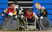 27 MAY 2013 - DONCASTER, GBR - Peter Hull (second from the right) tries to force a path between Johnny Mulhall (second from left) and Alan Lynch (right) of the Gaelic Warriors for his team mate Stephen Hickey during their 2013 Great Britain Wheelchair Rugby Nationals match at The Dome in Doncaster, South Yorkshire .(PHOTO (C) 2013 NIGEL FARROW)