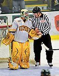 23 January 2009: University of Vermont Catamount goaltender Rob Madore, a Freshman from Venetia, PA, hands the puck over to a linesman after making a third period save against the University of Massachusetts Minutemen after the first game of a weekend series at Gutterson Fieldhouse in Burlington, Vermont. The Catamounts defeated the visiting Minutemen 2-1. Mandatory Photo Credit: Ed Wolfstein Photo