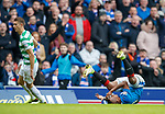 11.3.2018 Rangers v Celtic:<br /> Aldredo Morelos clutches his face after contact with Jozo Simunovic who is red carded