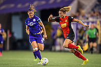Orlando, Florida - Sunday, May 14, 2016: Western New York Flash forward Lynn Williams (9) accelerates away from Orlando Pride defender Laura Alleway (5) during a National Women's Soccer League match between Orlando Pride and New York Flash at Camping World Stadium.