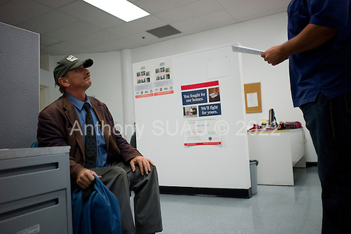 Los Angeles, California<br /> January 31, 2014<br /> <br /> PATH case workers locate the paper work and interview 55 yr old homeless Navy veteran David Hauser to see if he is eligible for a HUD Vash housing voucher. <br /> <br /> David has been homeless for three years.
