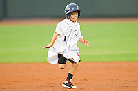 A young fan runs towards first base during a between innings promotion during the Carolina League game between the Frederick Keys and the Winston-Salem Dash at BB&T Ballpark on August 5, 2011 in Winston-Salem, North Carolina.  The Dash defeated the Keys 10-0.   Brian Westerholt / Four Seam Images