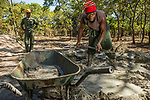 Men using cement to build new anti-poaching base, Kafue National Park, Zambia
