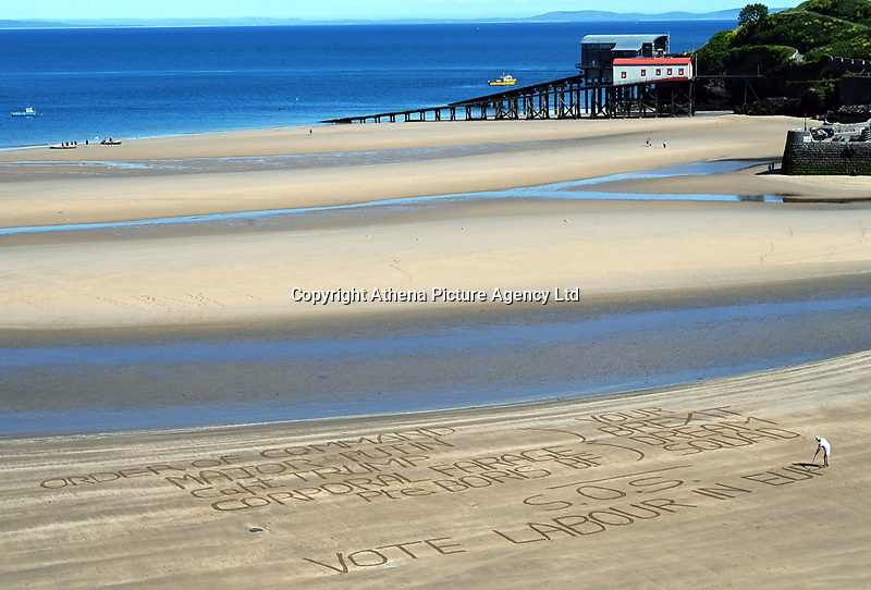 Pictured: The political slogan on Tenby beach, Wales, UK.<br /> Re: A political slogan has been created on the North Beach of Tenby by local resident Will Rossiter.<br /> The slogan in the south Pembrokeshire town reads: Order of Command: Major Putin, Your Capt. Trump, Brexit Corporal Farage, Dream pte Boris BF Squad, S.O.S Vote Labour.