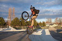 Former Hope Academy student, Zak, executes a move on his BMX bike at the local skate park, one of his favorite spots in Sequim. Zak ultimately decided to drop out of high school to pursue his GED. Photo: Meryl Schenker for The Hechinger Report
