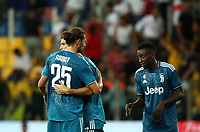 Calcio, Serie A: Parma - Juventus, Parma stadio Ennio Tardini, 24 agosto 2019. <br /> Juventus' Cristiano Ronaldo (c) celebrates with his teammates Adrien Rabiot (l) and Blaise Matuidi (r), after winning 1-0  the Italian Serie A football match between Parma and Juventus at Parma's Ennio Tardini stadium, August 24, 2019. <br /> UPDATE IMAGES PRESS/Isabella Bonotto