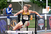 Missouri senior Leslie Farmer clears a hurdle in the 400 meter hurdles preliminaries at the 2012 Big 12 Outdoor Track and Field Championships on Saturday at Kansas State's R.V. Christian Track Complex in Manhattan, Ks. Farmer, who was a state champion for Jefferson City High School, bettered her school record with a time of 57.80 and finished 7th in the finals on Sunday with a time of 58.62 seconds.
