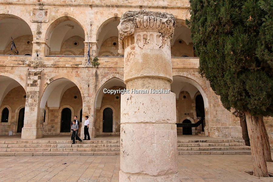 Jerusalem, Israel, The Jewish Quarter at the Old City. A Roman capital in Batei Makhase Square, the building was built in 1871 by the Rothchild family<br />