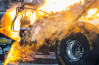 Oct 2, 2016; Mohnton, PA, USA; Detailed view of fire from the engine of NHRA top fuel driver Brittany Force after an explosion during the Dodge Nationals at Maple Grove Raceway. Mandatory Credit: Mark J. Rebilas-USA TODAY Sports