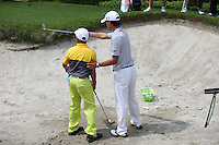 Matteo Manassero (ITA) gives a masterclass on bunker play during the Junior Clinic ahead of the 2014 Maybank Malaysian Open at the Kuala Lumpur Golf & Country Club, Kuala Lumpur, Malaysia. Picture:  David Lloyd / www.golffile.ie