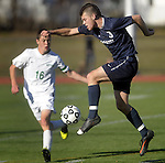 (Worcester, Ma 111613) Cohasset 3, Samuel Morris,  takes the ball off his foot, as Sutton 16, Evan Culross looks on,  in the second half,  Sutton High School beat Cohasset Middle High 4-0 during the MIAA State Boys Division Four Final, Saturday, November 16, 2013, at Foley Stadium in Worcester. (Jim Michaud Photo) For Sunday