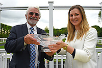 Connections of Many Dreams receive their trophy during Afternoon Racing at Salisbury Racecourse on 18th May 2017