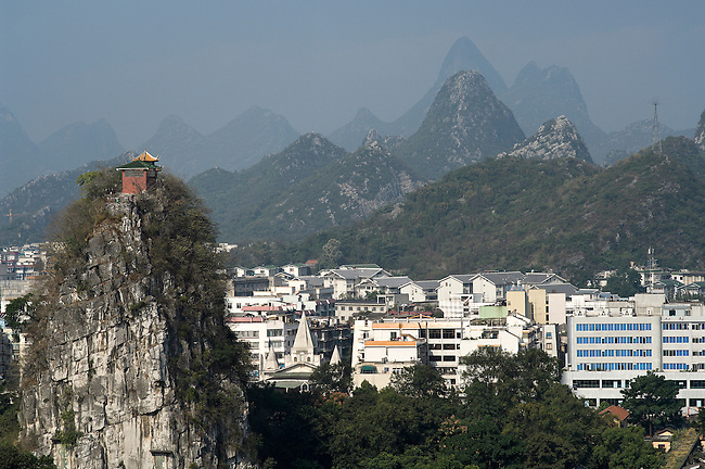 Guilin has expanded into the Karst hills; from Wave Subduing Fubo Hill, China