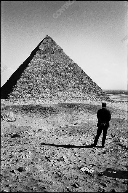 """Egyptian president Anwar Al-Sadat photographed in front of the Chephren Pyramid for Time magazine's """"Man of the Year"""" issue shortly after his meeting with Israeli prime minister Menachem Begin. Egypt, December 1977"""