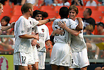3 July 2004: Eddie Gaven (right) is congratulated by Amado Guevara (20), Sergio Galvan Rey (third from right), Jeff Parke (12), and other teammates after his goal in the 18th minute had given the MetroStars a 1-0 lead. DC United defeated the MetroStars 6-2 at RFK Stadium in Washington, DC during a regular season Major League Soccer game..