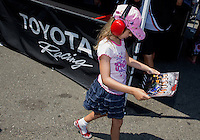 Jul. 26, 2013; Sonoma, CA, USA: NHRA a young fan admiring a Hero Card of her favorite Toyota drivers in the Toyota display during qualifying for the Sonoma Nationals at Sonoma Raceway. Mandatory Credit: Mark J. Rebilas-
