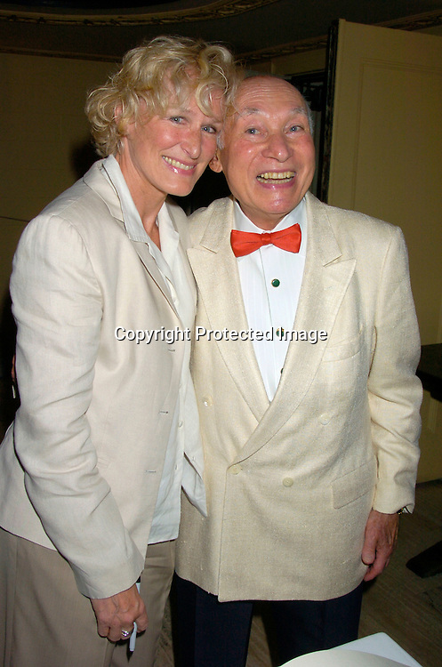 Glenn Close and George Lang..at George Lang's 80th Birthday at Cafe des Artistes on ..June 15, 2004 in New York City. City Meals-on-..Wheels and City Harvest are benefiting from the evening. ..George Lang owns Cafe des Artistes. ..Photo by Robin Platzer, Twin Images