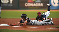 NWA Democrat-Gazette/J.T. WAMPLER NWA Naturals' Jecksson Flores tags Arkansas Travelers' Yonathan Mendoza at third base Monday May 14, 2018 at Arvest Ballpark in Springdale.