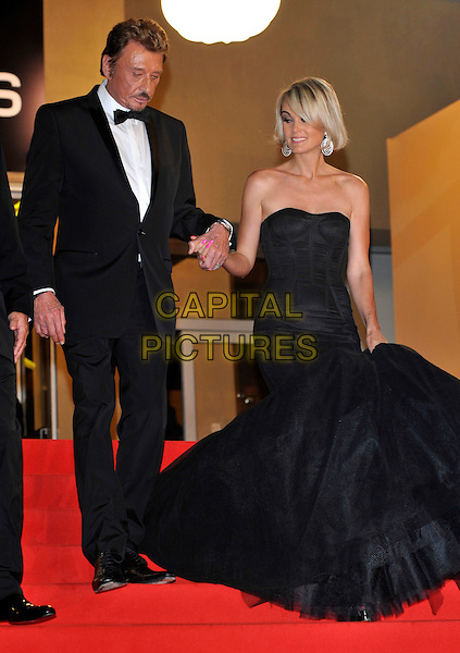 JOHNNY HALLYDAY, LAETITIA HALLYDAY.'Vengance' screening.62nd International Cannes Film Festival.Cannes, France. 17th May 2009.full length black strapless bustier fishtail dress gown tux tuxedo married couple husband wife holding hands steps  .CAP/PL.©Phil Loftus/Capital Pictures
