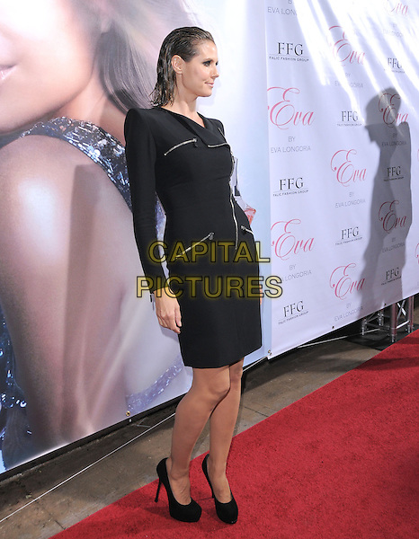 HEIDI KLUM.The Eva by Eva Longoria Fragrance Launch held at Beso in Hollywood, California, USA. .April 27th, 2010.perfume full length black wet hair slicked back coat jacket zip zippers dress shoulder pads long sleeves profile .CAP/RKE/DVS.©DVS/RockinExposures/Capital Pictures.