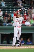 Second baseman Yoan Moncada (24) of the Greenville Drive bats in a game against the Lexington Legends on Monday, May 18, 2015, at Fluor Field at the West End in Greenville, South Carolina. Moncada, a 19-year-old prospect from Cuba, made his professional debut tonight in the Red Sox organization. (Tom Priddy/Four Seam Images)