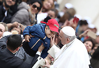 Papa Francesco accarezza un bambino al suo arrivo all'udienza generale del mercoledi' in Piazza San Pietro, Citta' del Vaticano, 31 ottobre 2018.<br /> Pope Francis caresses a child as he arrives to lead his weekly general audience in St. Peter's Square at the Vatican, on October 31, 2018.<br /> UPDATE IMAGES PRESS/Isabella Bonotto<br /> <br /> STRICTLY ONLY FOR EDITORIAL USE