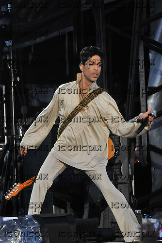 PRINCE performing live with his purple piano on Day 3 on the Main Stage at the Hop Farm Music Festival in Kent UK - 03 Jul 2011.  Photo credit: George Chin/IconicPix