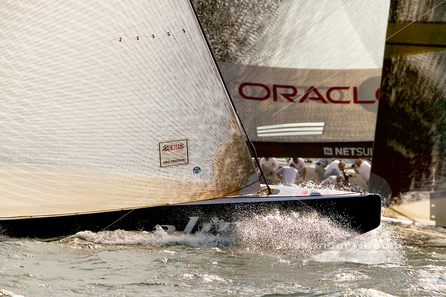 USA, Newport RI - June, 2004 -America's cup boats Oracle and Alighi round the leward mark in the 2004 USB trophy race.
