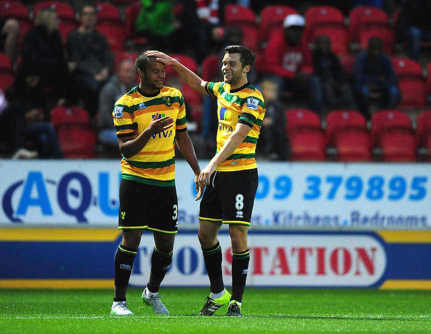 Norwich City's Jonathan Howson, right, celebrates scoring his sides first goal with team-mate Vadis Odjidja-Ofoe who claimed an assist on the goal<br /> <br /> Photographer Chris Vaughan/CameraSport<br /> <br /> Football - Capital One Cup Second Round - Rotherham United v Norwich - Tuesday 25th August 2015 - New York Stadium - Rotherham<br />  <br /> &copy; CameraSport - 43 Linden Ave. Countesthorpe. Leicester. England. LE8 5PG - Tel: +44 (0) 116 277 4147 - admin@camerasport.com - www.camerasport.com
