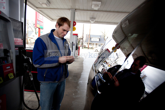 Hospitality management senior Colton Fick pumps gas at Speedway on Wedesday, March 9, 2011. Fick and his friend, Dan Sigler plan to make the drive to Key West for Spring Break on Friday.  Photo by Britney McIntosh | Staff